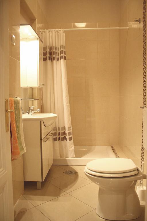 bathroom with washing machine in Villa San Giuseppe Lovran Croatia